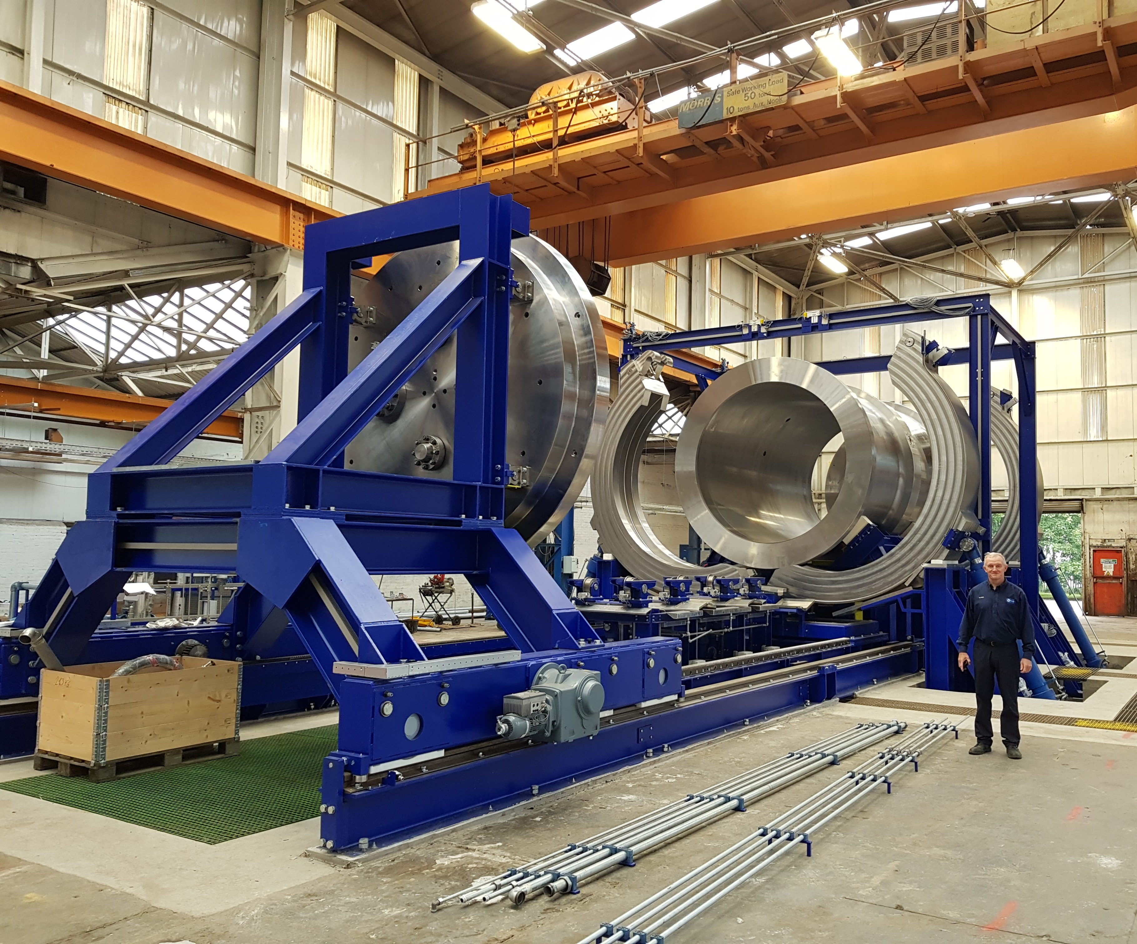 Tyne Subsea General Manager, Paul Smith, next to Tyne Subsea's largest hyperbaric chamber to show its scale